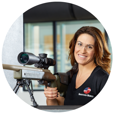 Shooters World employee holding rifle with scope
