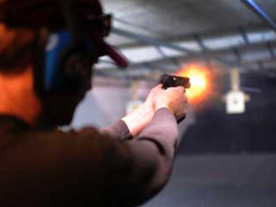 Man shooting pistol at gun range
