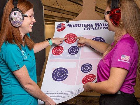 Ladies looking at their shooting range target